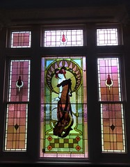 Wayville. Stained glass window in Mawson House which was built in 1909. The central panel of this window was replaced with this French madam. Probably in the 1960s when Bernard Vigor ran an upmarket French restaurant in the house.