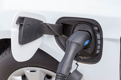 An electric car by Ford is being tanked with a TankE device at the E-Cologne trade show for electric mobility