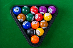 Top view of billiard balls on green table