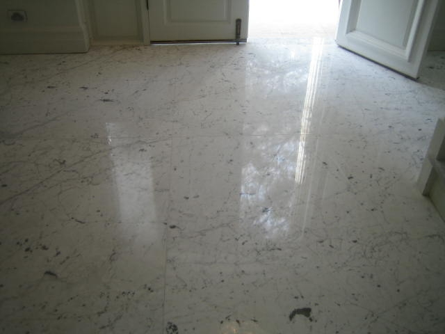 laying-grinding-and-polishing-of-carrara-marble