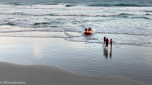 Surf Lifesaver girls practising with rescue boat.