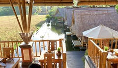 Each of the thatched huts below is its own table on the water. We sat at the second one for dinner.