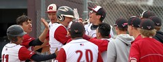 Nick Norris (center) is congratulated by teammates after his fourth inning, two-run home run cut the Erie lead to 4-2. - PLDL7716.bigger
