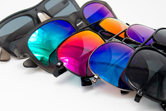 Collection of sun glasses on white background
