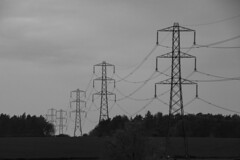 Marching pylons: Cotswolds, England, UK