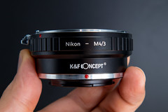Side view of a Nikon F to Micro Four Thirds adapter