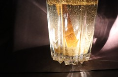 Gold glitter stirred in water with larger file size