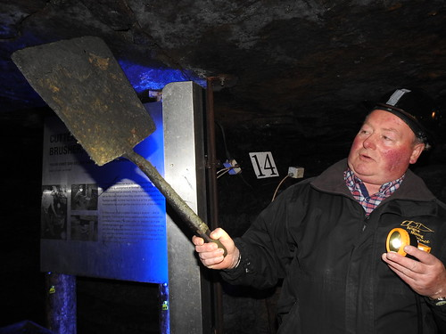 Our guide [a former miner] demonstrates the short shovel used at Arigna Mining Experience. The coal seams were only 20in high and the miners had to crawl in sideways to shovel out the coal onto a waggon, called a 'hutch'.