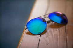 Blue sunglasses on a wooden surface