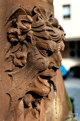 Un des 3 mascarons appartenant à la fontaine de la place du marché aux choux à Wissembourg.