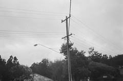 Power lines pole and street light