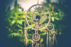 Dreamcatcher sunset , boho chic, ethnic amulet,symbol, tropical background.