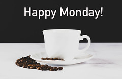 Cup of coffee with Happy Monday! text