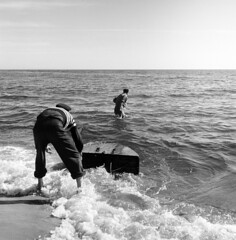 Fishermen with a corf, Kungabaden, Magdehem, Skåne, Sweden