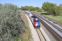 A UTA Frontrunner train led by an MP36 heads towards Ogden, UT