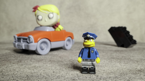 Officer Wiggum has his eye on Traffic