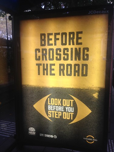 'Before Crossing the Road' advertising on bus stop, Sydney