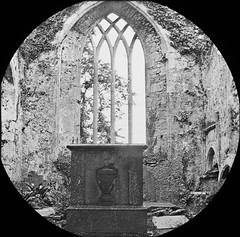 Window with possible baptismal font to fore.