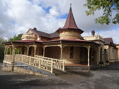 Wayville Adelaide. Mawson House built in 1909 in Queen Anne style but with crenulations above the bay windows and more above main entrance porch.