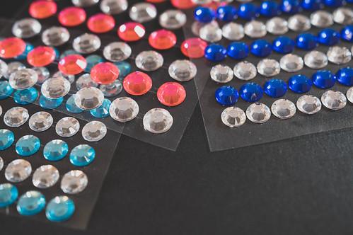 Diamond stickers on a black surface