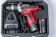 Electric screwdriver with battery in black tool case