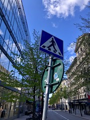 Pedestrian crossing sign on a city street