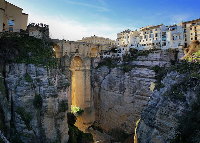 The late sun-rays beaming through Puente Nuevo in Ronda