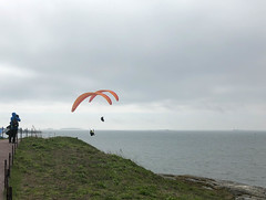 Paragliders above the walls of the Suomenlinna Fortress