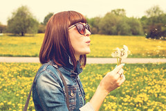 Woman blowing on dandelion3-Green-Wind