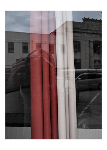 Curtains in a vacant storefront window