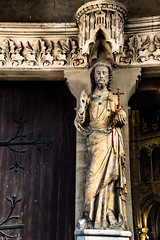 Ancient statue in front of the main entrance to the Petit Andely Saint Sauveur Church, Normandy Region, France -45