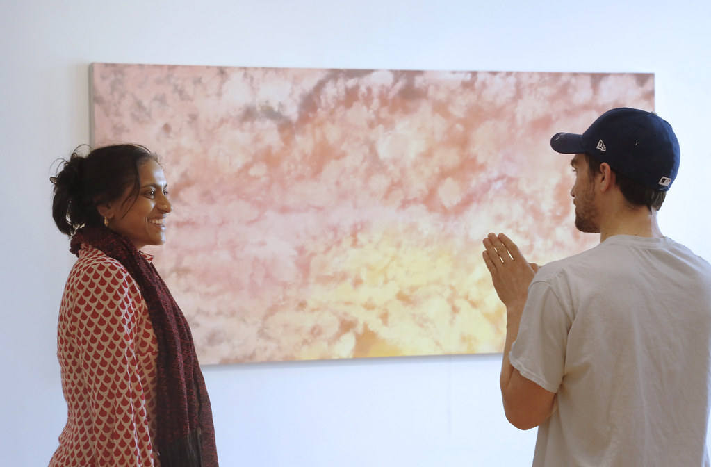 Teiger Mentor in the Arts Chitra Ganesh (left), with Chet Moye Lubarsky (M.F.A. '19) at his thesis exhibition in John Hartell Gallery.