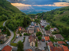 Village in the valley by sunset