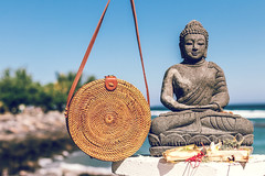 Nude natural organic handmade rattan handbag closeup.