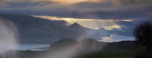 Rays of light coming through rainy clouds above the Lijar Mountains