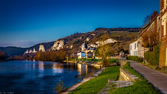 Sunset view of the riverside walkway along Seine River in Les Andelys, France -61a