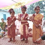Three young girls at Kulun School with their traditional outfits