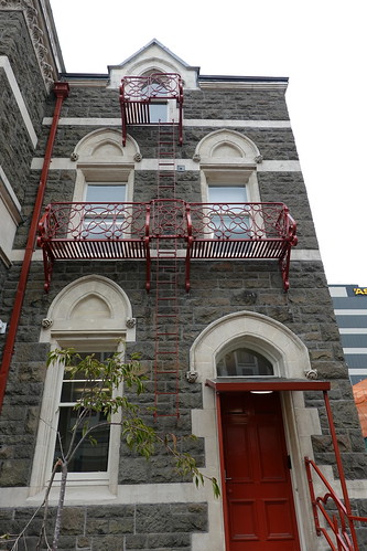 Red door and fire escapes