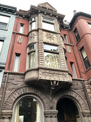 Romanesque revival house with multistory oriel and sculptural details, S Street NW, Washington, D.C.
