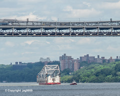 Old Tappan Zee Bridge Superstructure Remains floating on the Hudson River past the George Washington Bridge, New York City