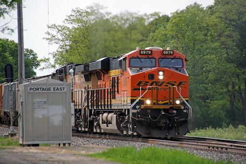 BNSF 6979 and a UP motor lug EB potash train 680 toward the Portage East switch