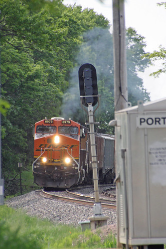 BNSF 6979 chugs into action, accelerating EB unit potash train 680 out of Portage East
