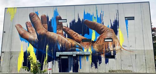 Hands of God by Matt Adnate