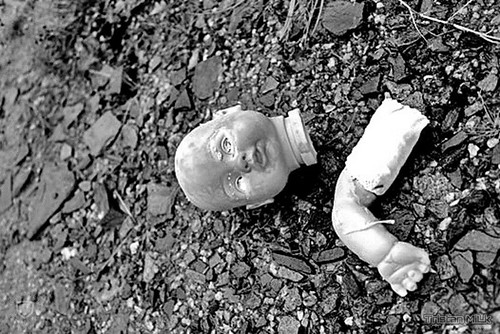 mutilated doll body