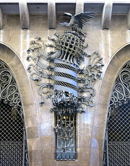 An ornate ironwork sculpture grows from a small window guard, Palau Güell (1886-88) by Gaudí, Barcelona