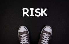 Sneaker shoes with risk text