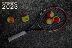 """Five coloured tennis balls and a tennis racket on stone, next to the text """"Wimbledon 2023"""""""