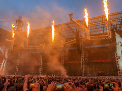 Rock fans in front of the stage set with flamethrower for the WorldWired tour - Metallic concert in Cologne, Germany