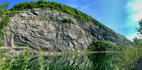 Abandoned stone quarry with lake near Thiersee, Tyrol, Austria