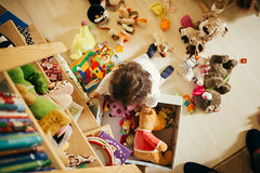 A cute little girl playing with toys at home